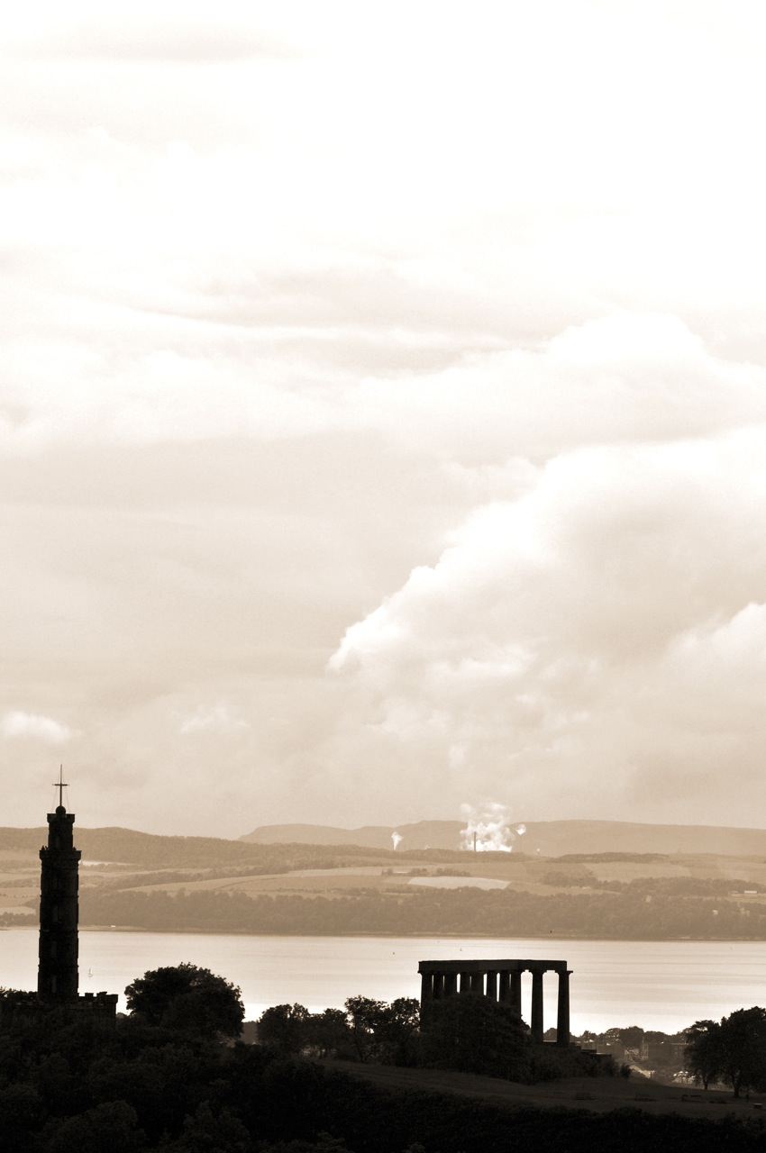From the Cliff top. Dwarfing the National Monuments. Edinburgh. Scotland.