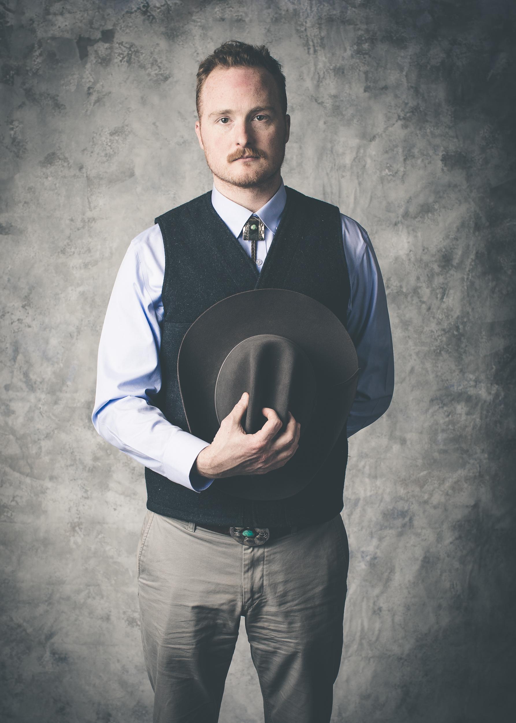 man-with-cowboy-hat-studio-portrait.jpg