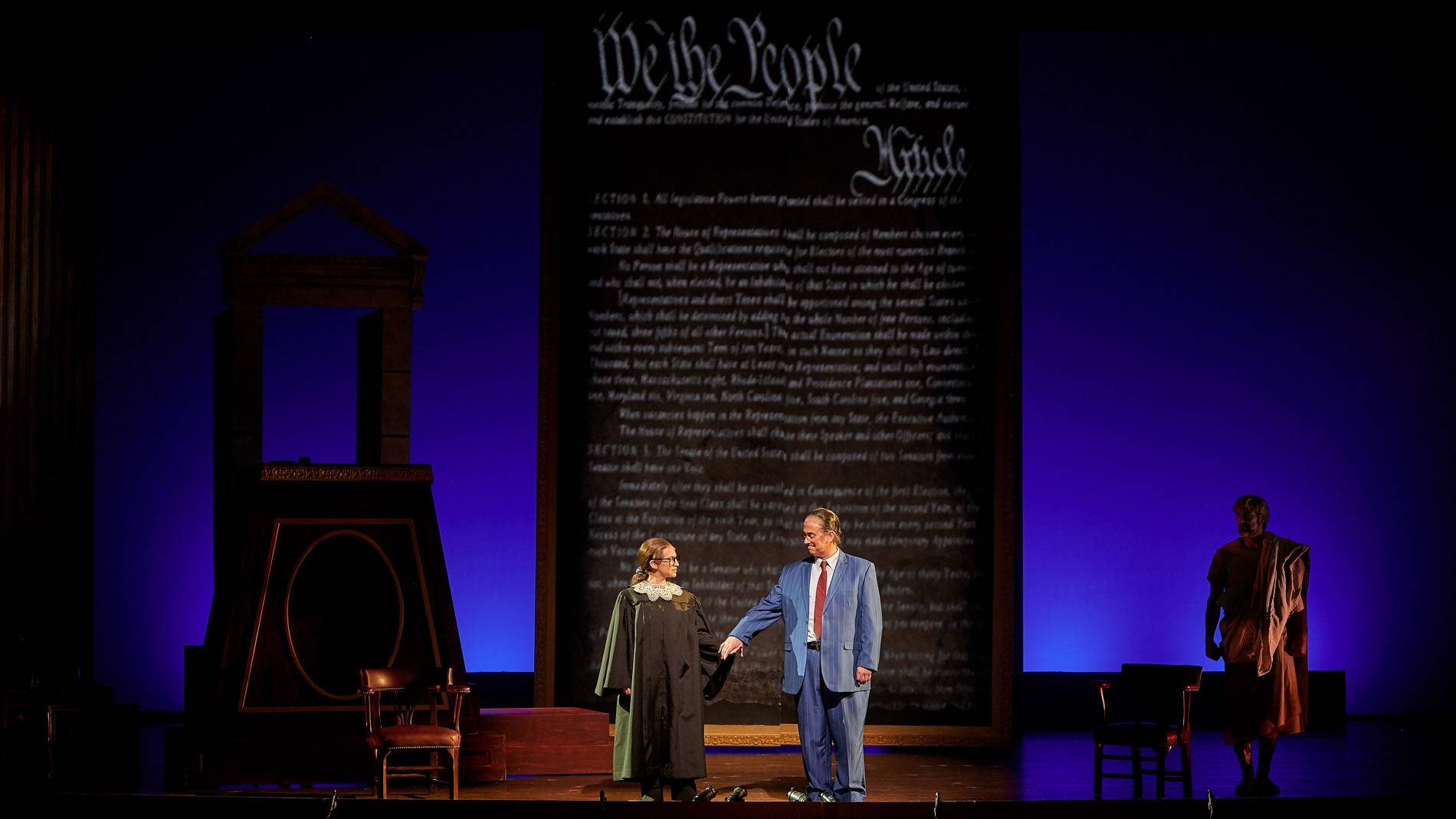 """We are different. We are one"": the 2019 OperaDelaware production of  Scalia/Ginsburg . L to R: Jennifer Zetlan (Justice Ginsburg), Brian Cheney (Justice Scalia), Ben Wager (The Commentator). Photo: Justin Heyes, Moonloop Photography."