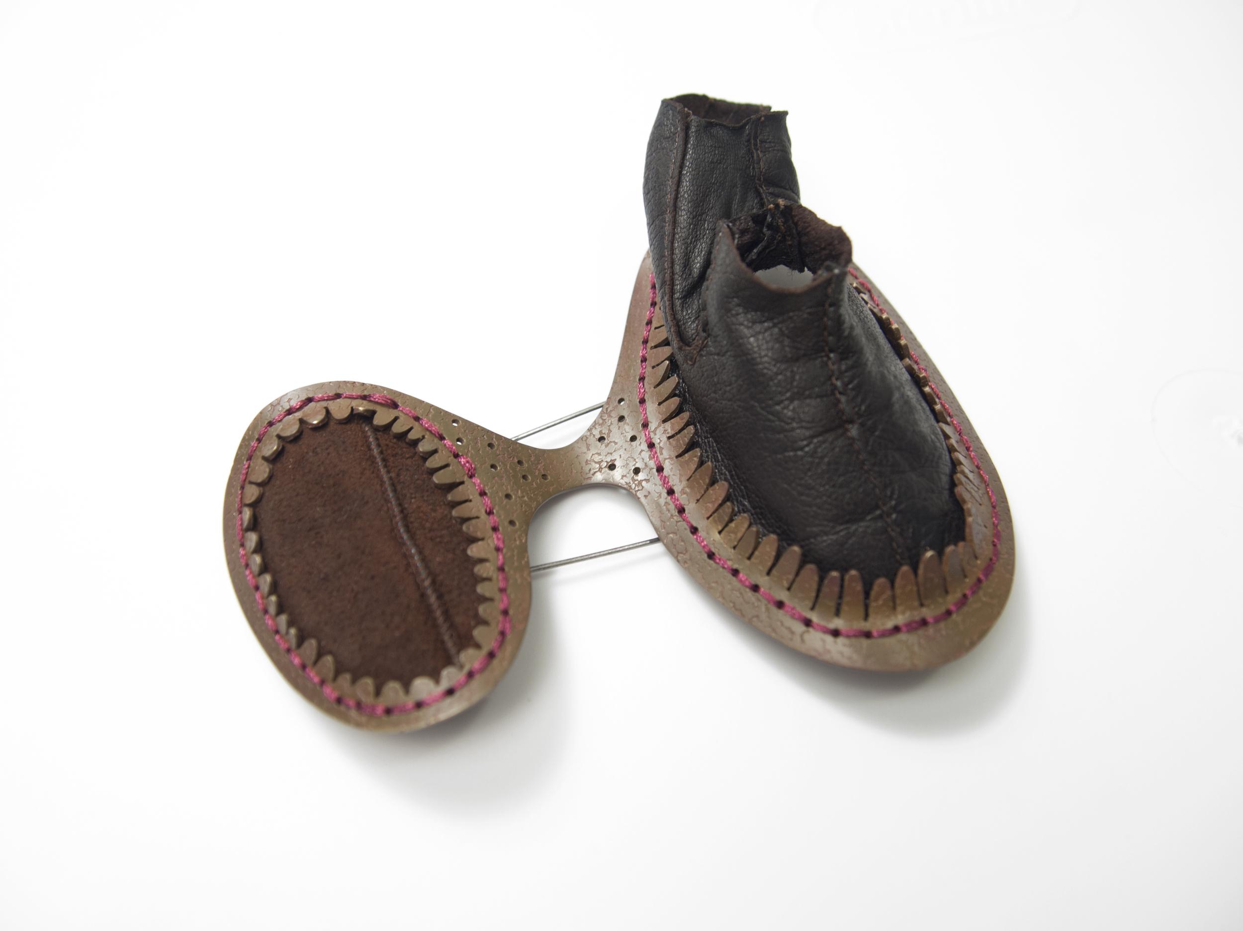 brooch (2016)  Leather, brass, thread