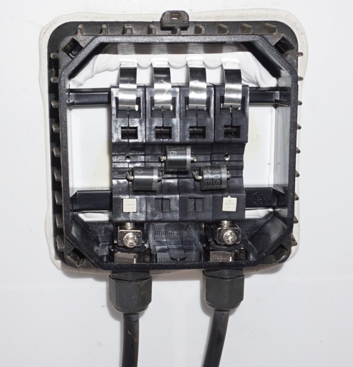 Inside a junction box of a typical 60 cell solar panel showing the 3 bypass diodes