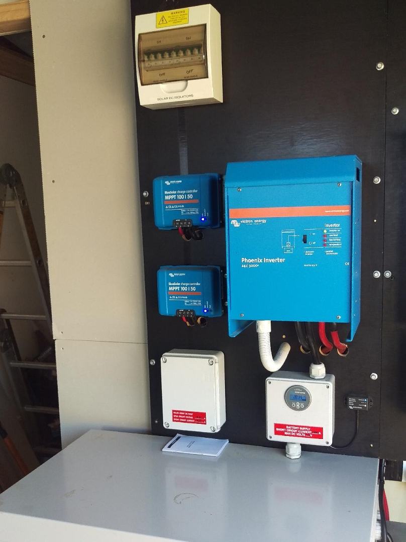 24V DC coupled off-grid solar system with 2 x Victron Bluesolar charge controllers, 2.4kW solar array and Victron Phoenix 2.4kW battery inverter.