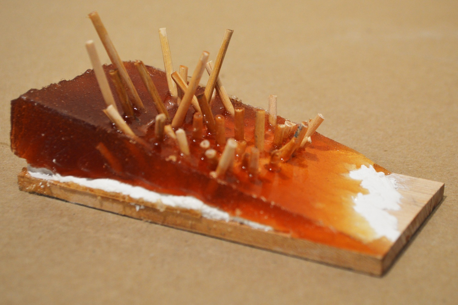 Maple wood, plaster, liquid silicone rubber, wooden dowels.