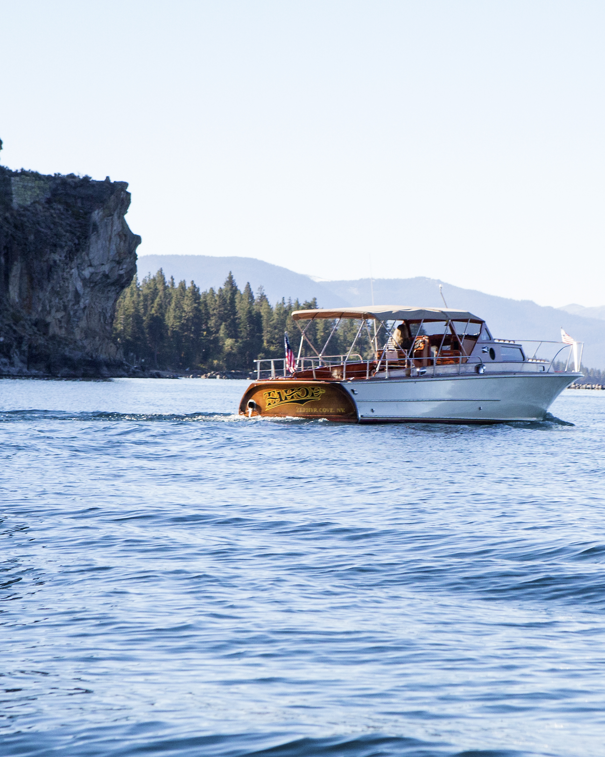"""The Tahoe passing the """"Lady of the Lake"""" as she looks out on Lake Tahoe from Cave Rock."""