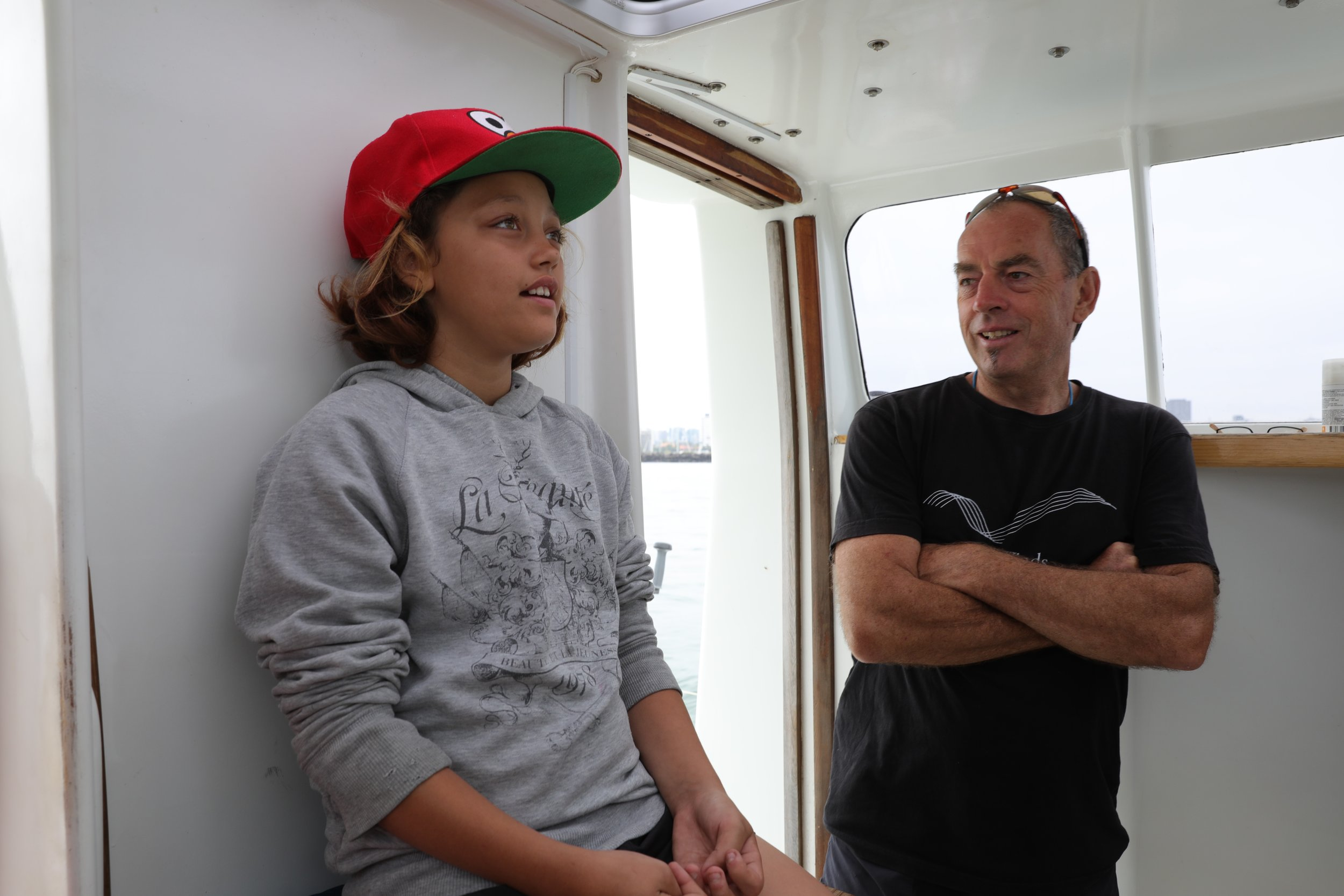"""The Captain teaching the youngest on board about Pelican1's auto pilot after he was asked- """"Who's driving the boat?"""""""