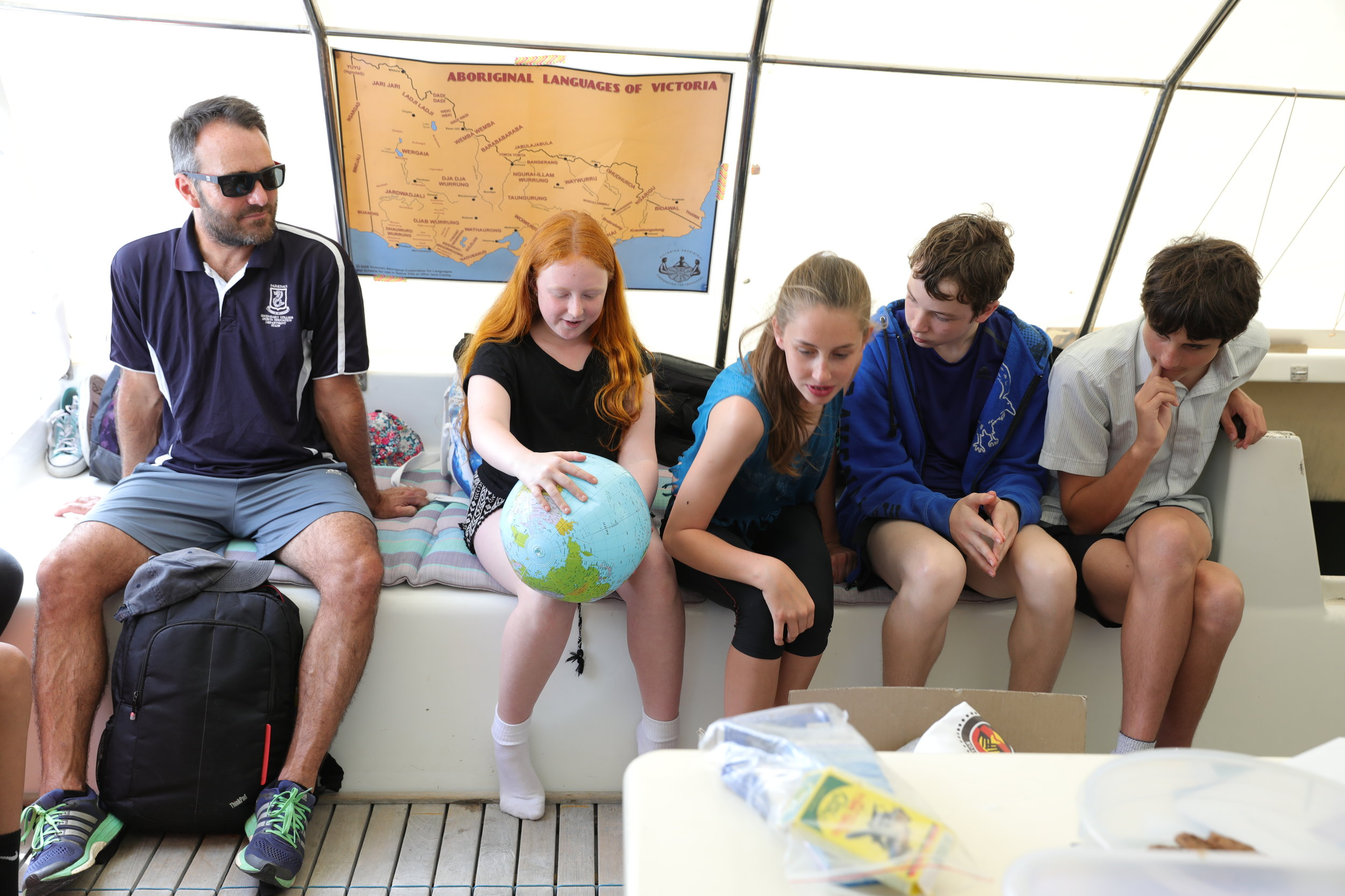 Young students learning that Earth should perhaps be called Ocean as over 70% of the planet is covered in water.