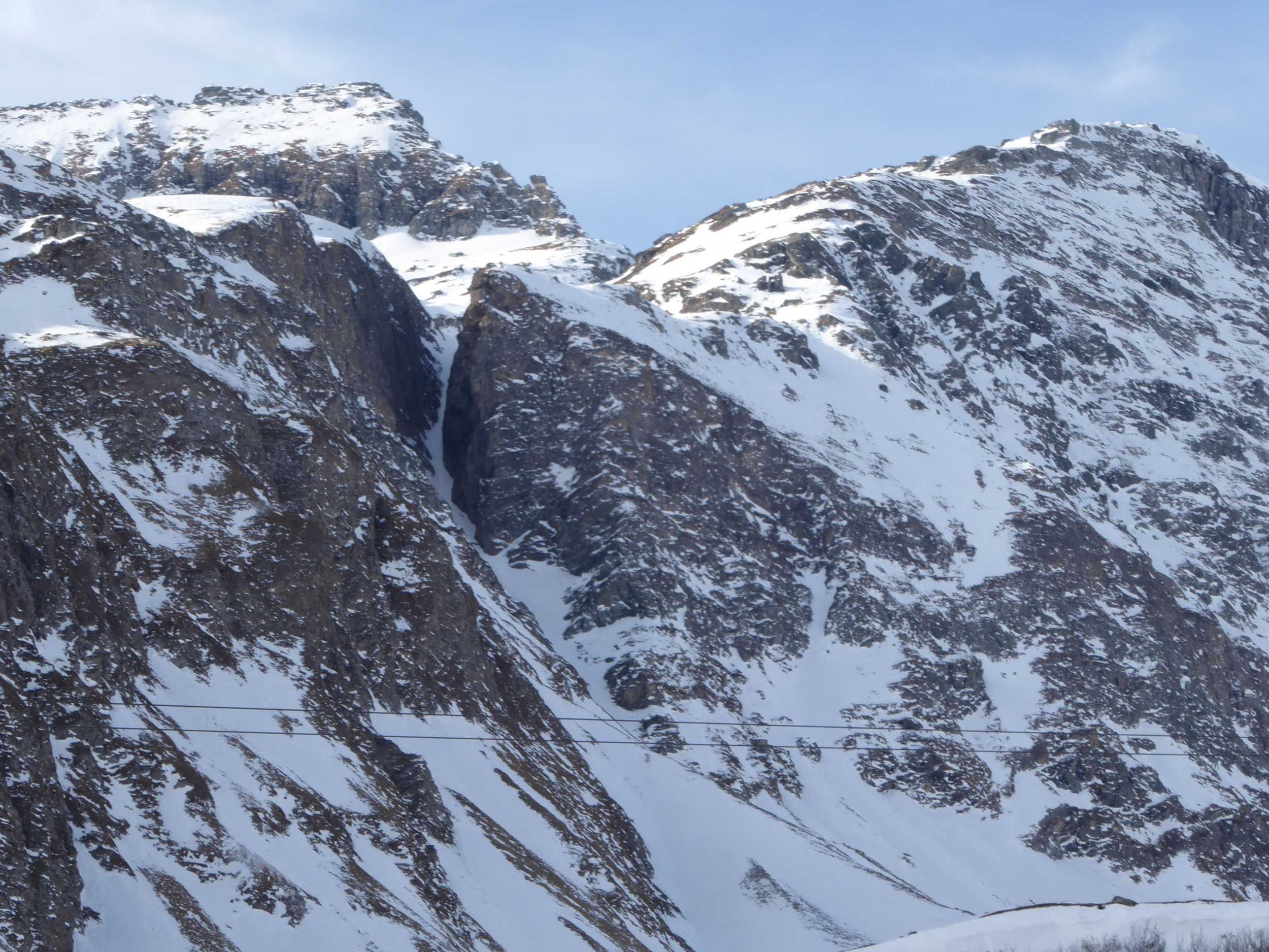 we skied the awesome tight couloir between those two hefty cliffs. it was one of the coolest lines I have ever skied!