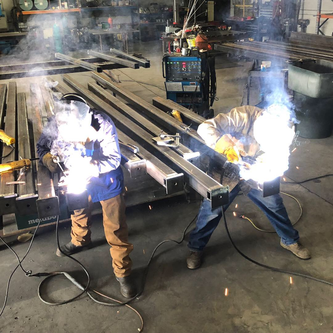 Ryan and Kasdan welding structural members for Beale AFB.
