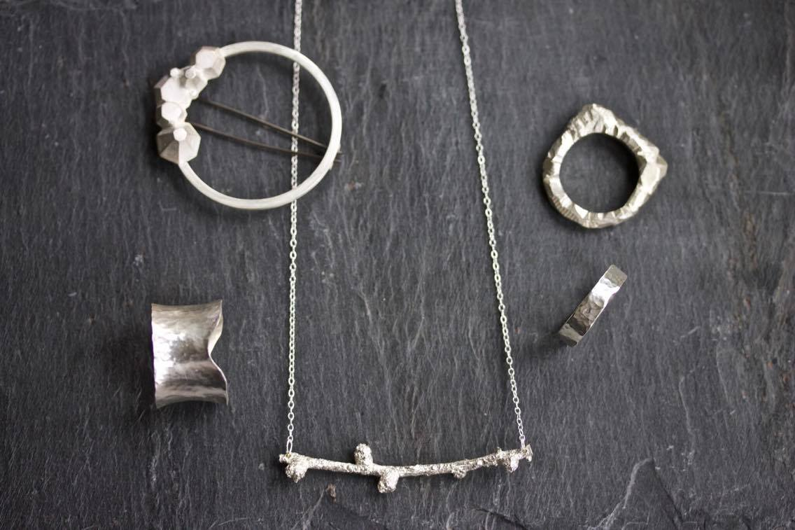 LUCY TOMS   Lucy Toms jewellery is silver, minimal, elegant and often dressed with unique gemstones.