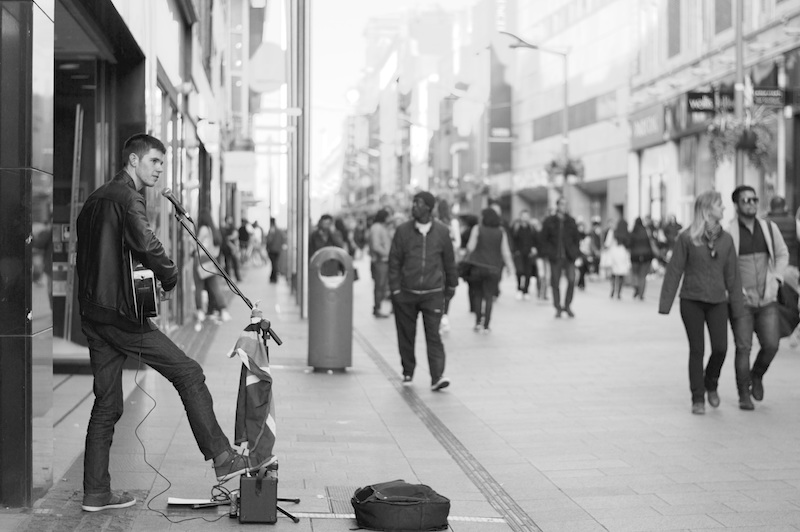 busker singing on the street