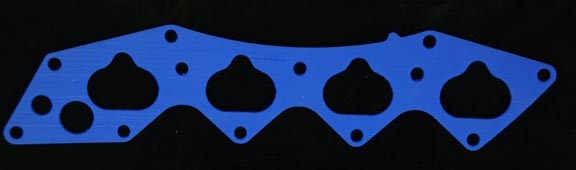 Hondata have developed a special high temperature insulating gasket which replaces the stock intake gasket. This and bypassing several heat sources significantly reduces the transfer of heat from the head to the intake and incoming air giving you up to 5% more power.    Turbocharged cars often use an aluminum intercooler to cool the air compressed by the turbo. The intake manifold is also made of aluminum but because it is heated by the head from combustion and coolant, works in reverse to an intercooler by heating the intake air by as much as 50° C.    Fact: For every 3.3 °C (5° F) rise in intake temperature, air density drops 1%. The hotter the air, the less fuel the computer injects to compensate for reduced oxygen. HondaLogger datalogging software has enabled us to measure intake air temperature under varied driving conditions.    Around town, testing has shown an average drop of around 10 degrees C which is good for around 3 percent power increase. Remember though that 3 percent power increase is difficult to feel. You'd feel a greater change in performance getting rid of that passenger. In certain conditions a 30° C drop has been measured.    The Honda manifold is heated in up to 5 places. From the head, the interior heating takeoff hose, the cold idle valve, the idle control valve and the throttle body heater. The Heatshield gasket kit contains an insulating gasket, and installation instructions. A race version only version with the thermostat bypass blocked is also available.