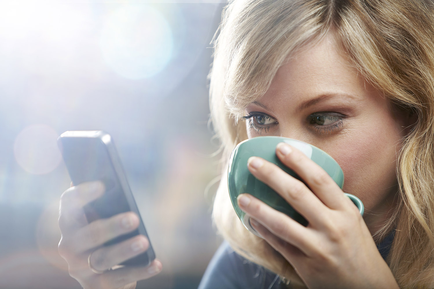 Woman using mobile phone to view website