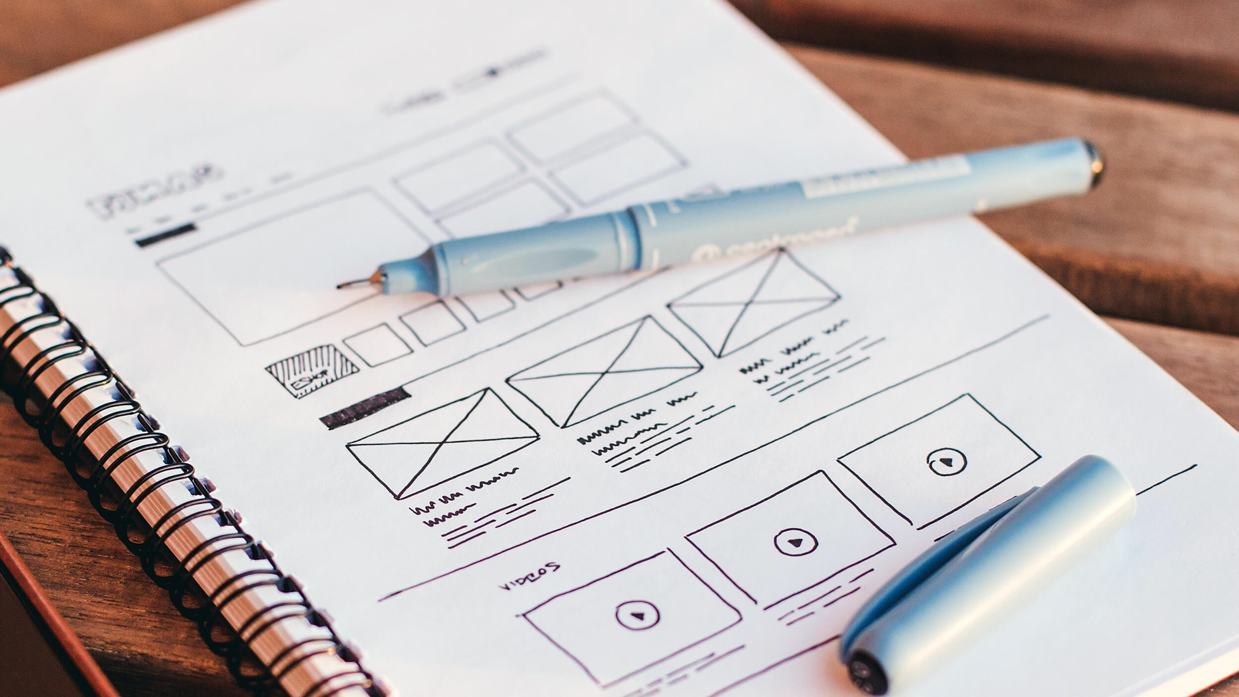 Squarespace Web Design Specialists - Wireframing a design in a notebook