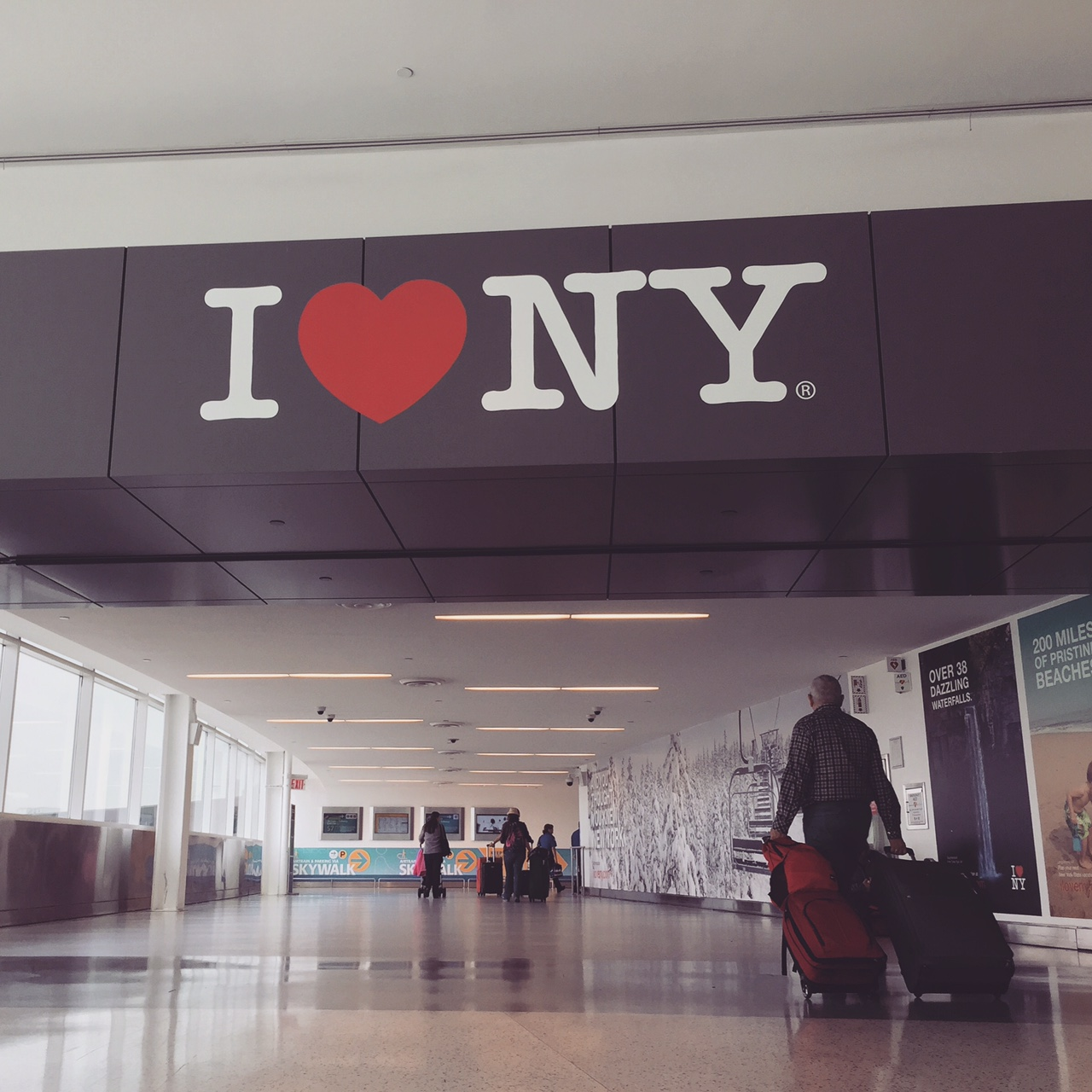 Walking through JFK International Airport to Etihad Airways gate.