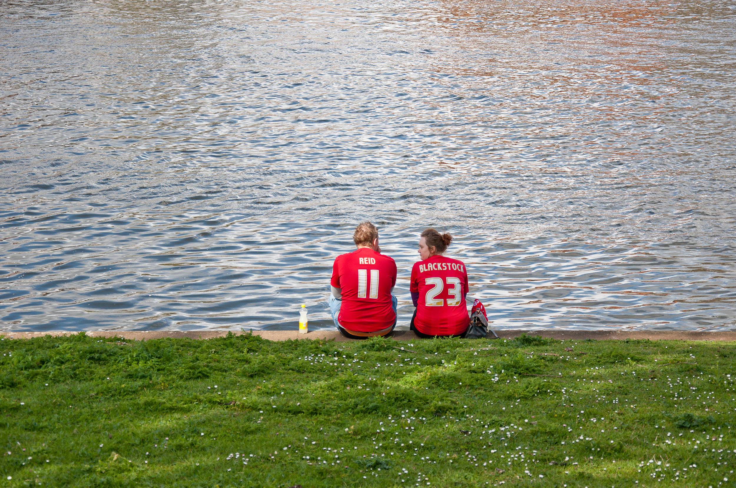 A couple sitting on the bank of the river Trent waiting for kick off against Leicester City during the season of 2012.