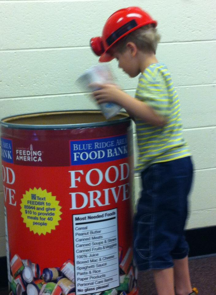 An attendee donating to the food bank at our 2013 Gordon Avenue Library show in Charlottesville.
