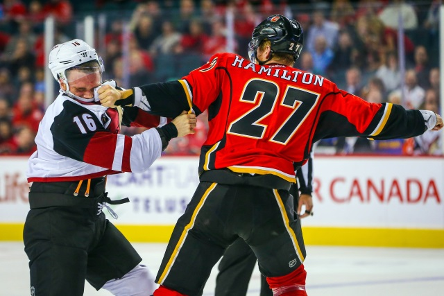 Pictured: Dougie Hamilton convinces Max Domi of the Phoenix Coyotes that he should broaden his intellectual horizons once his face heals.