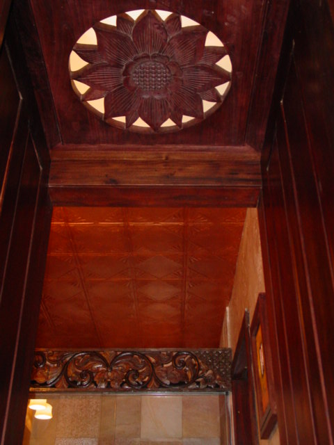 copper leaf tray ceiling custom carved doors and frames - lotus detail backlit lighting custom made for client