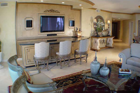 custom designed and built bar with hand carved ornamental wood carving media center, custom finishes