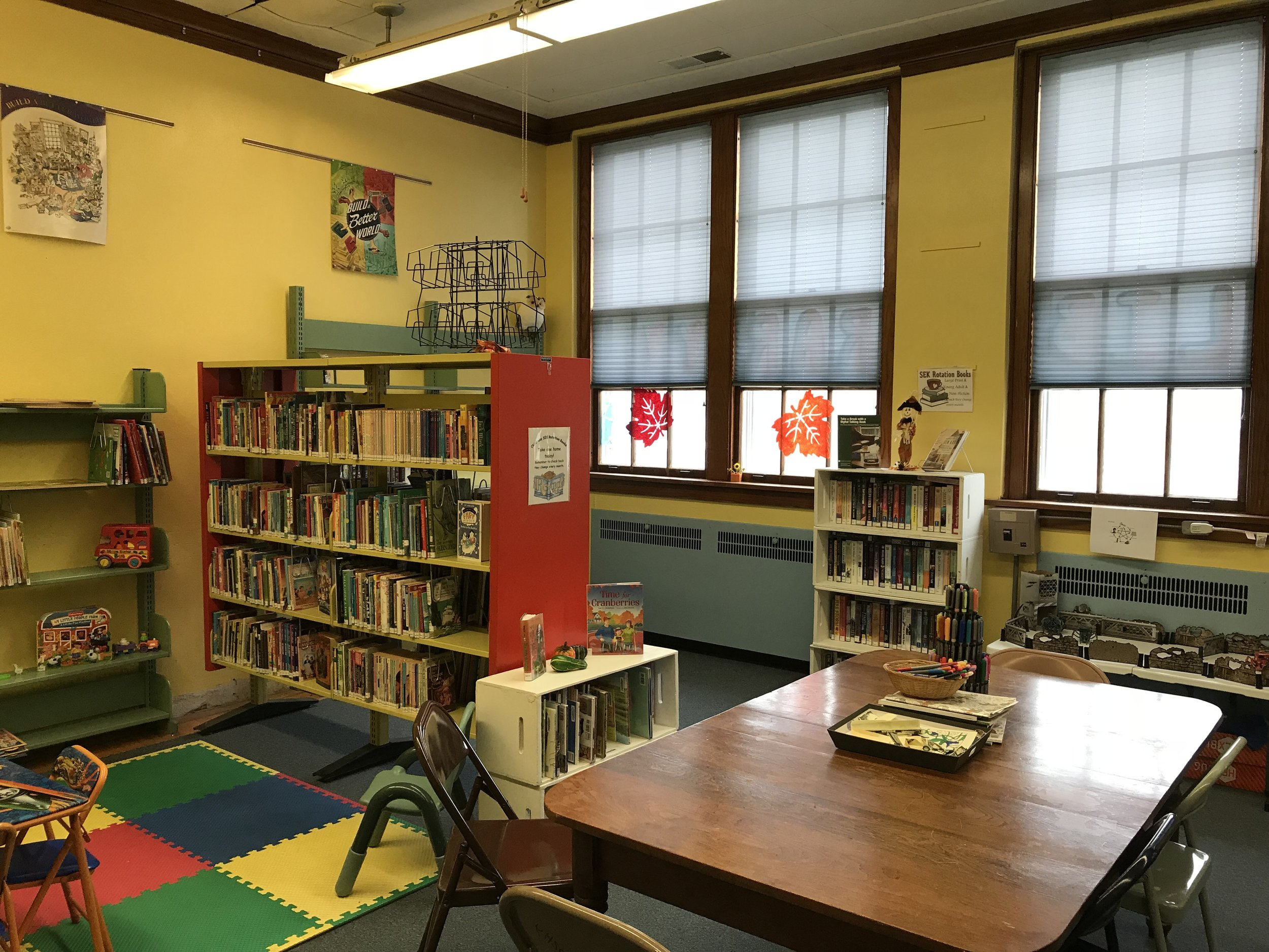 The library serves a population of over 300 with 24/7 Wi-Fi, even though the building is only open 15 hours per week.