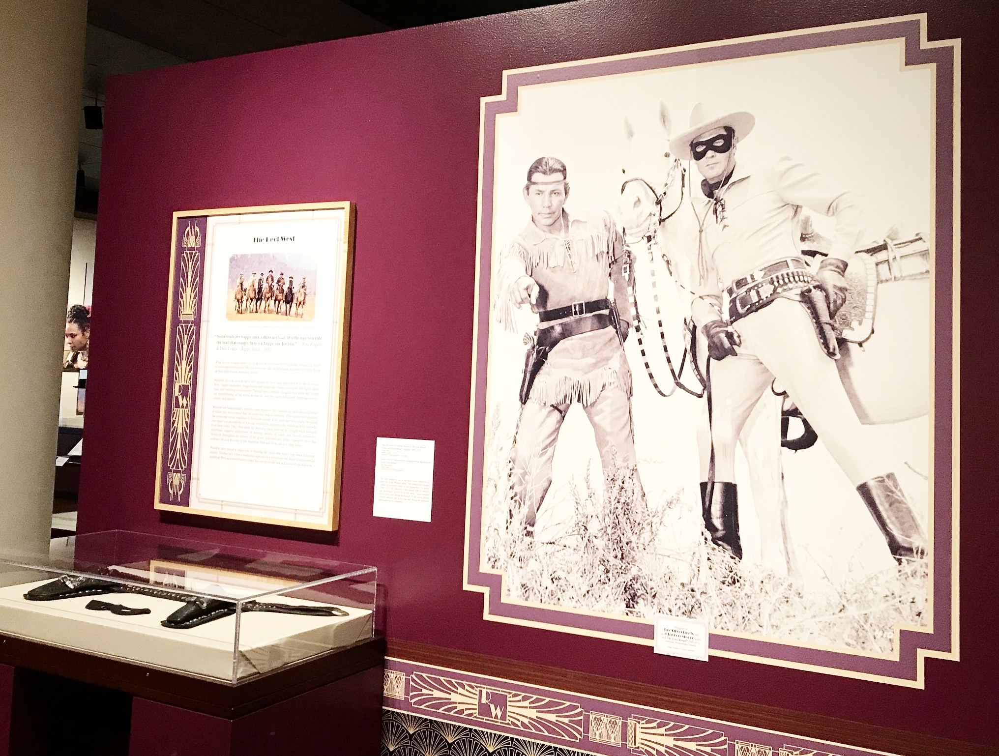 The Lone Ranger and Tonto loom large at the entrance to the Eiteljorg's Reel West exhibit, along with Clayton Moore's gunbelt and mask.