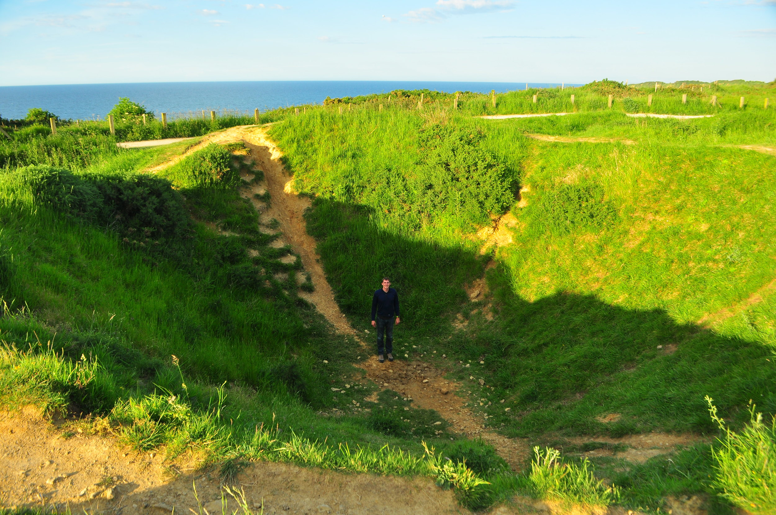 Point du Hoc is covered with pits like this that were hit with bombs