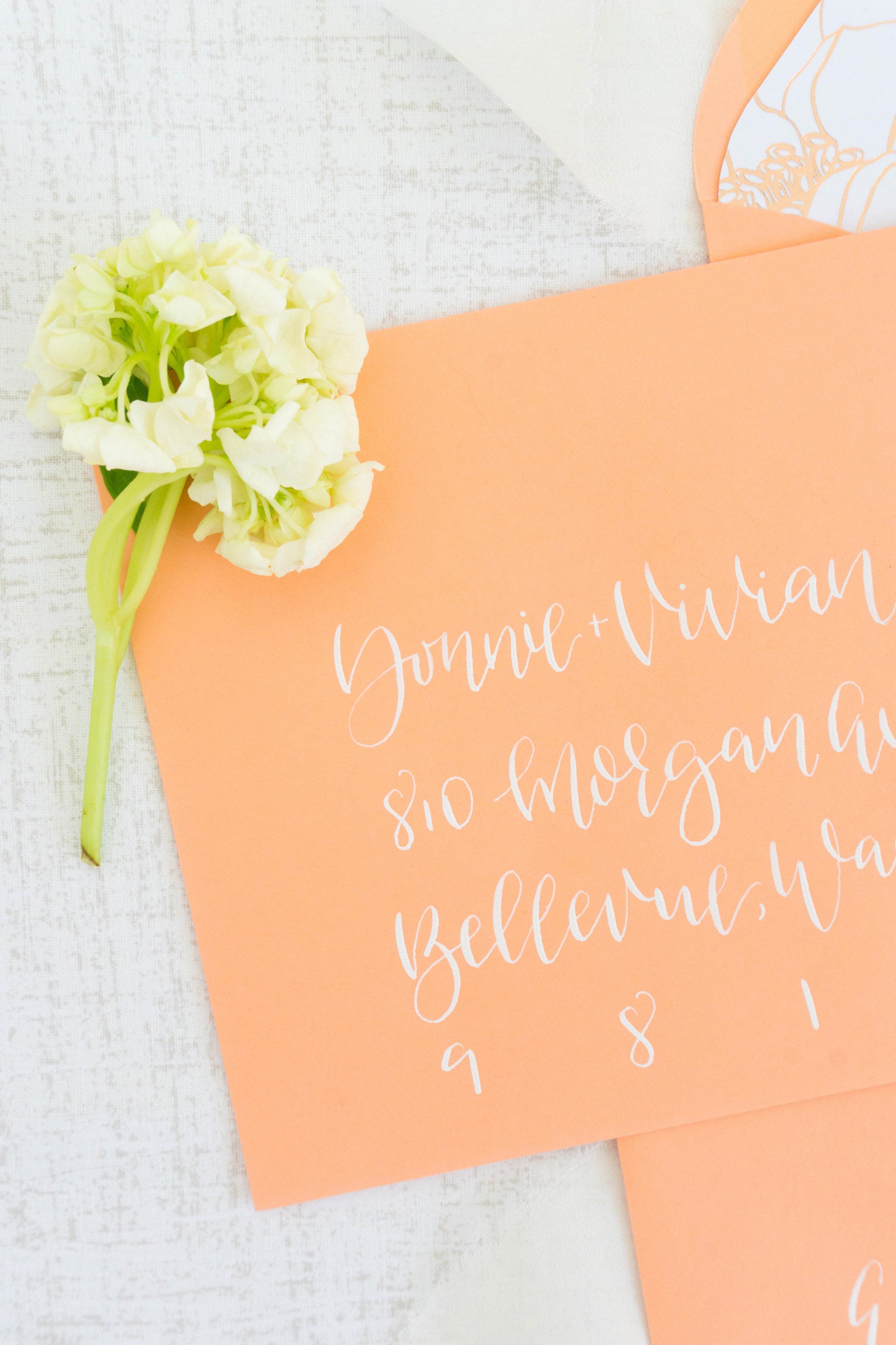 love-fern-design-studio-custom-wedding-invitations-for-the-modern-couple-modern-calligraphy-in-seattle-washington-custom-wedding-stationery-coral-white-floral-envelope-liner