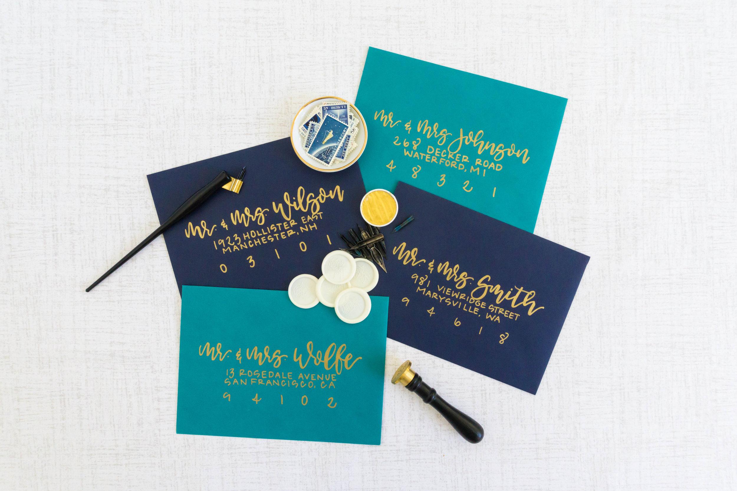 love-fern-design-studio-custom-wedding-invitations-for-the-modern-couple-modern-calligraphy-in-seattle-washington-custom-wedding-stationery-navy-gold-teal-envelopes
