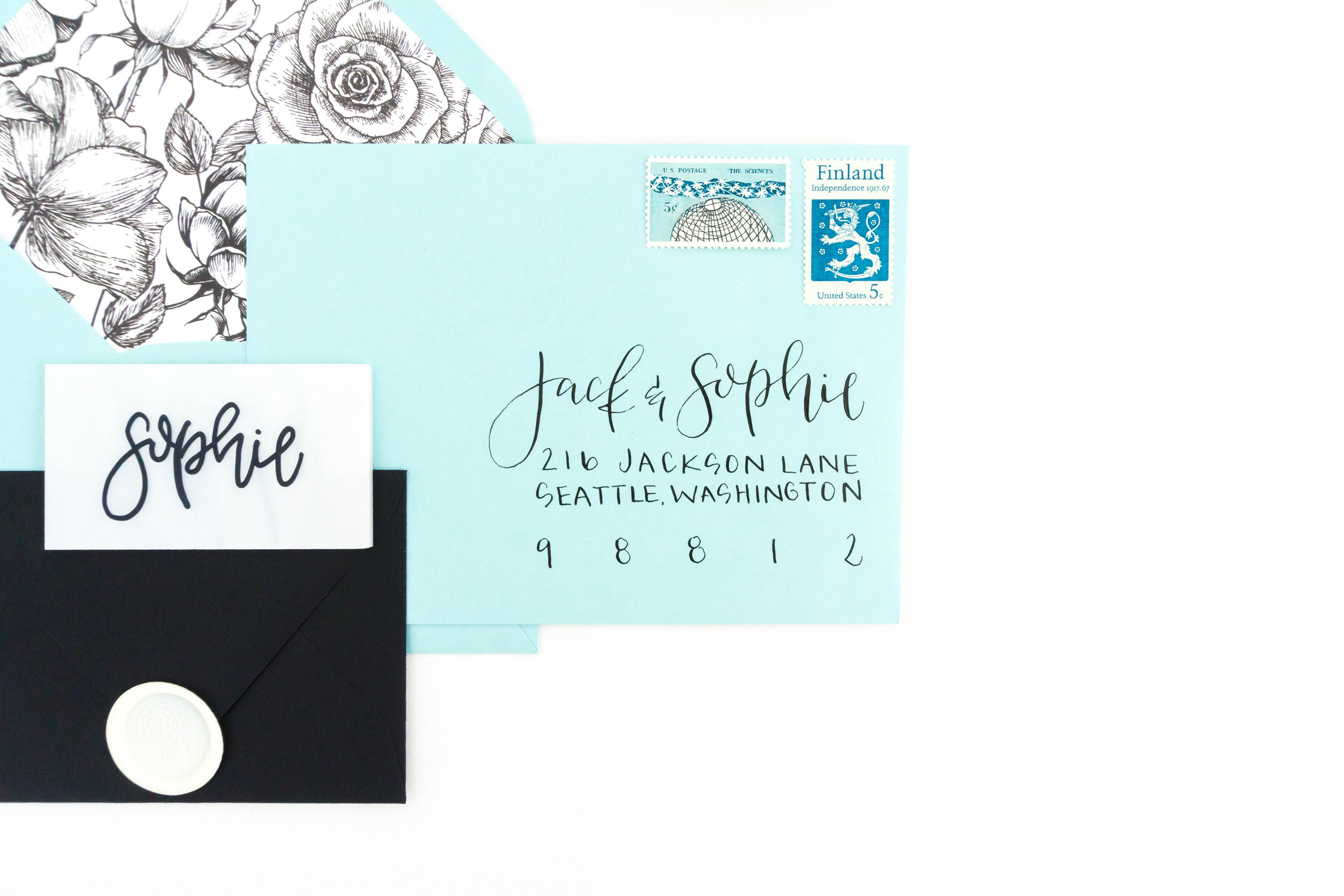 love-fern-design-studio-custom-wedding-invitations-for-the-modern-couple-modern-calligraphy-in-seattle-washington-custom-wedding-stationery-teal-envelopes-with-floral-liner-and-wax-seal