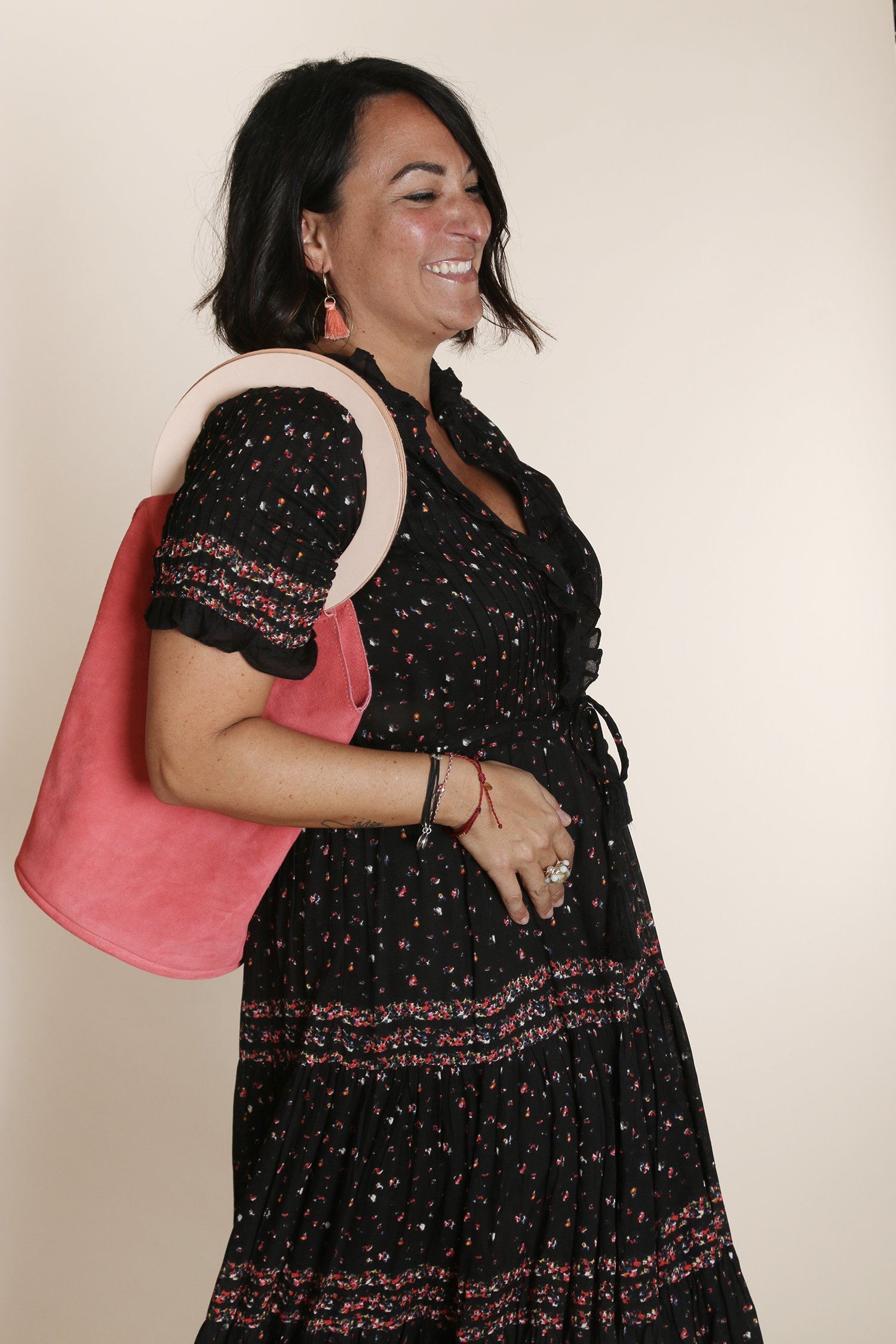Susi, her contagious smile, HoneyBird coral tassel earrings, and our suede tote