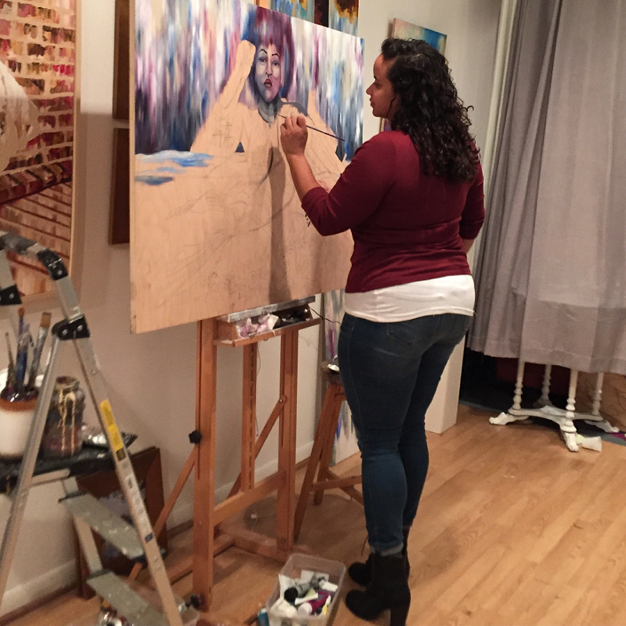 """the artist in studio working on her """"Sirens"""" painting."""