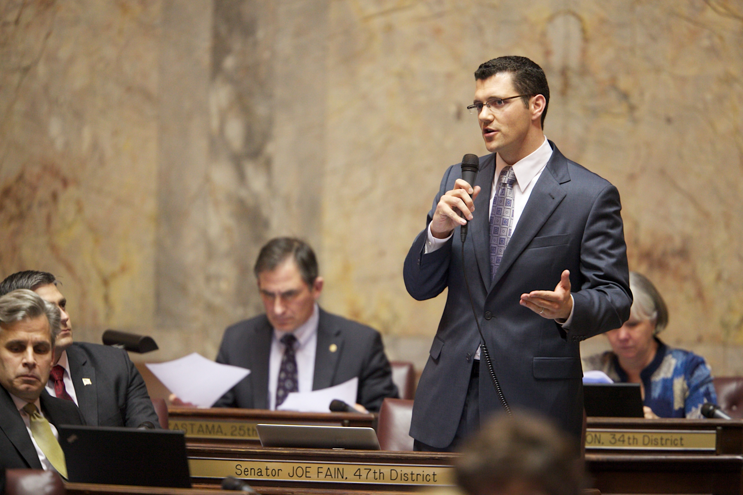 Joe speaking on the floor of the Washington State Senate.