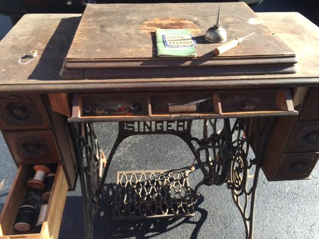 This Singer sewing machine dates back to the early 1900's and belonged to our client's grandmother.  Because of it's sentiment we thought it would be so cool to incorporate it into her boutique space that was under renovation.  It had all the right bones, but would need a little sprucing up!