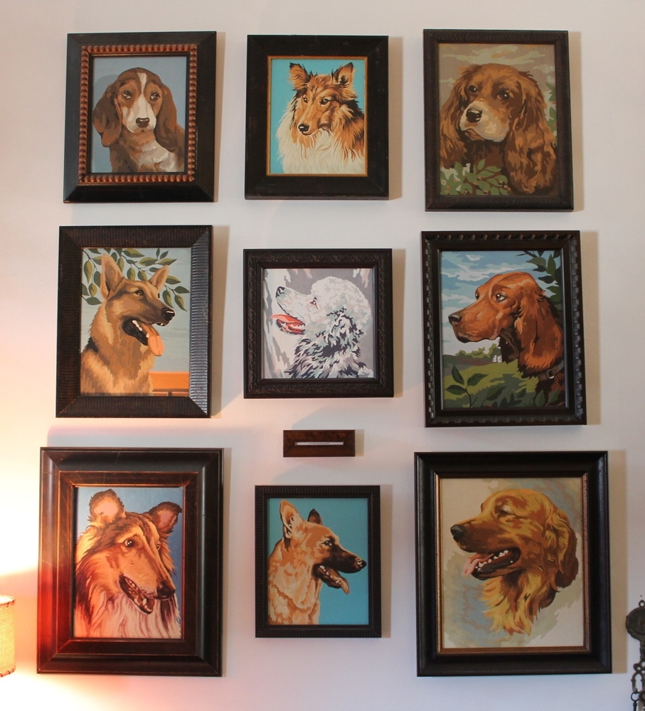 Collection of vintage paint-by-number dog portraits at Memento