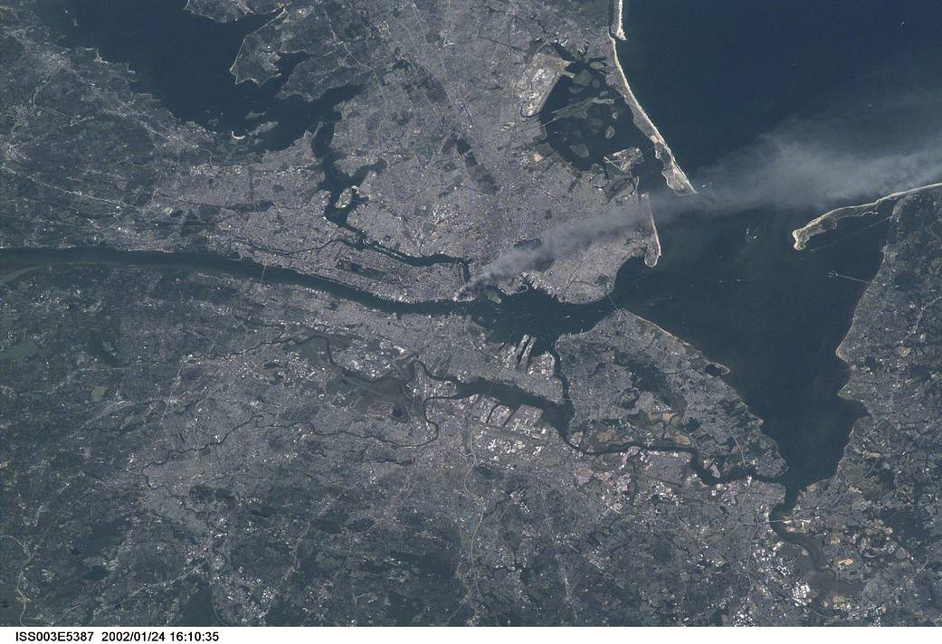 Photograph Credit: Frank Culbertson, Astronaut and Station Commander, United States Aeronautics and Space Administration - On Board the International Space Station, 2001/09/11 - World Trade Center from the International Space Station.