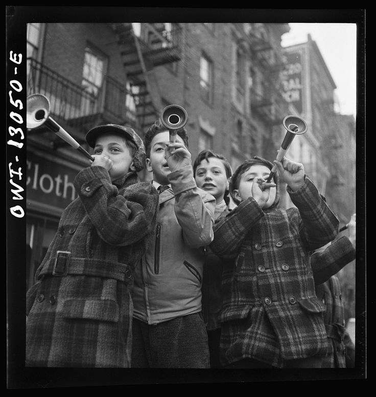 via Photographer Marjory Collins in New York City, NY, USA in January 1943 - Blowing Horns on Bleeker Street on New Year's Day