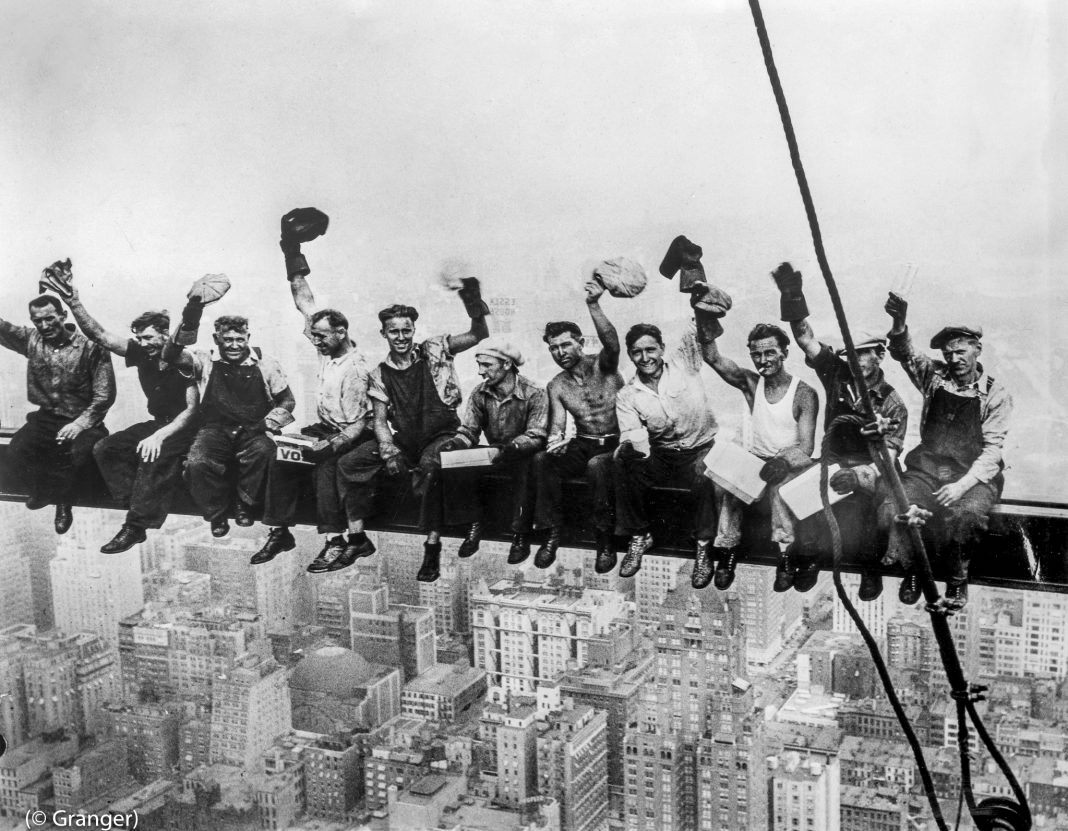 Construction workers sit on a New York City skyscraper girder in 1932. The building today is known as Rockefeller Plaza. (Image Credit © Granger)