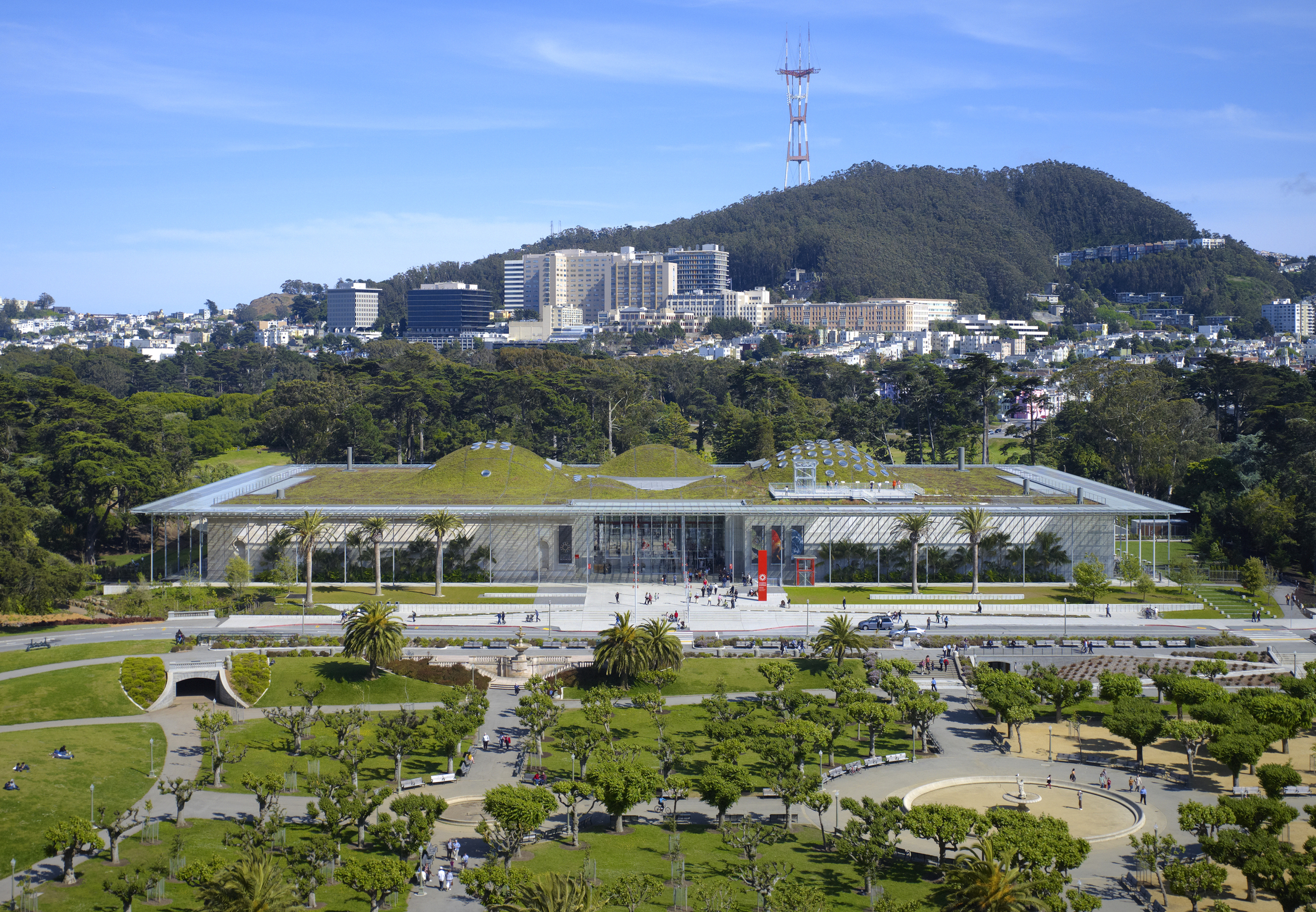 The California Academy of Sciences within Golden Gate Park. UCSF and Sutro Tower in the background.  ©Tim Griffith