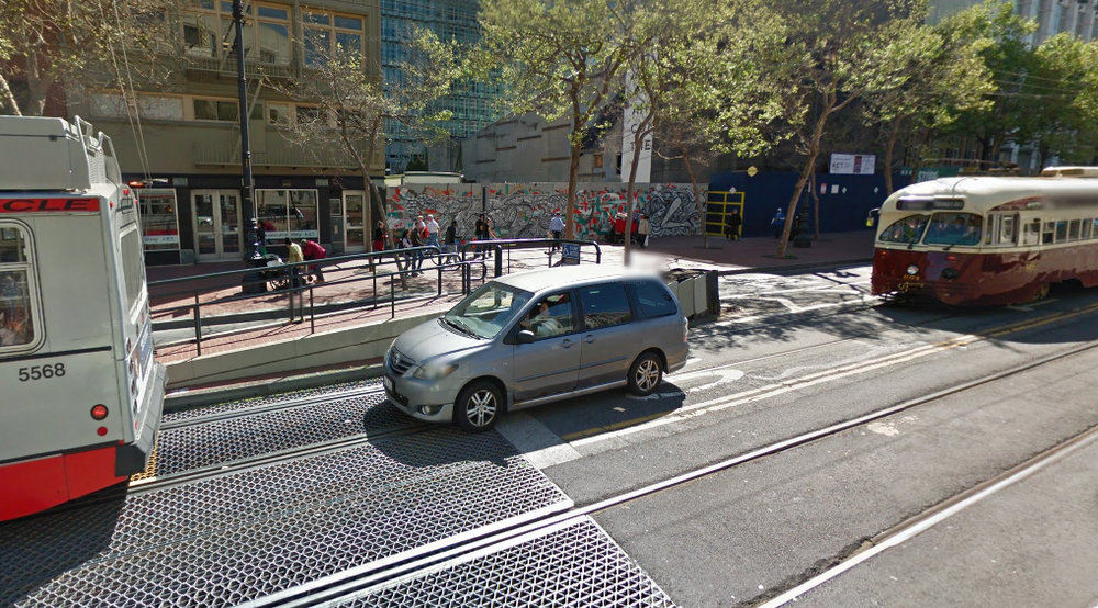 Hey there Minivan! Welcome to the big city. Now could you get out of the transit lane? The streetcar would like to pull up to that islandfor pedestrians to unload and load. Photo: Google Maps