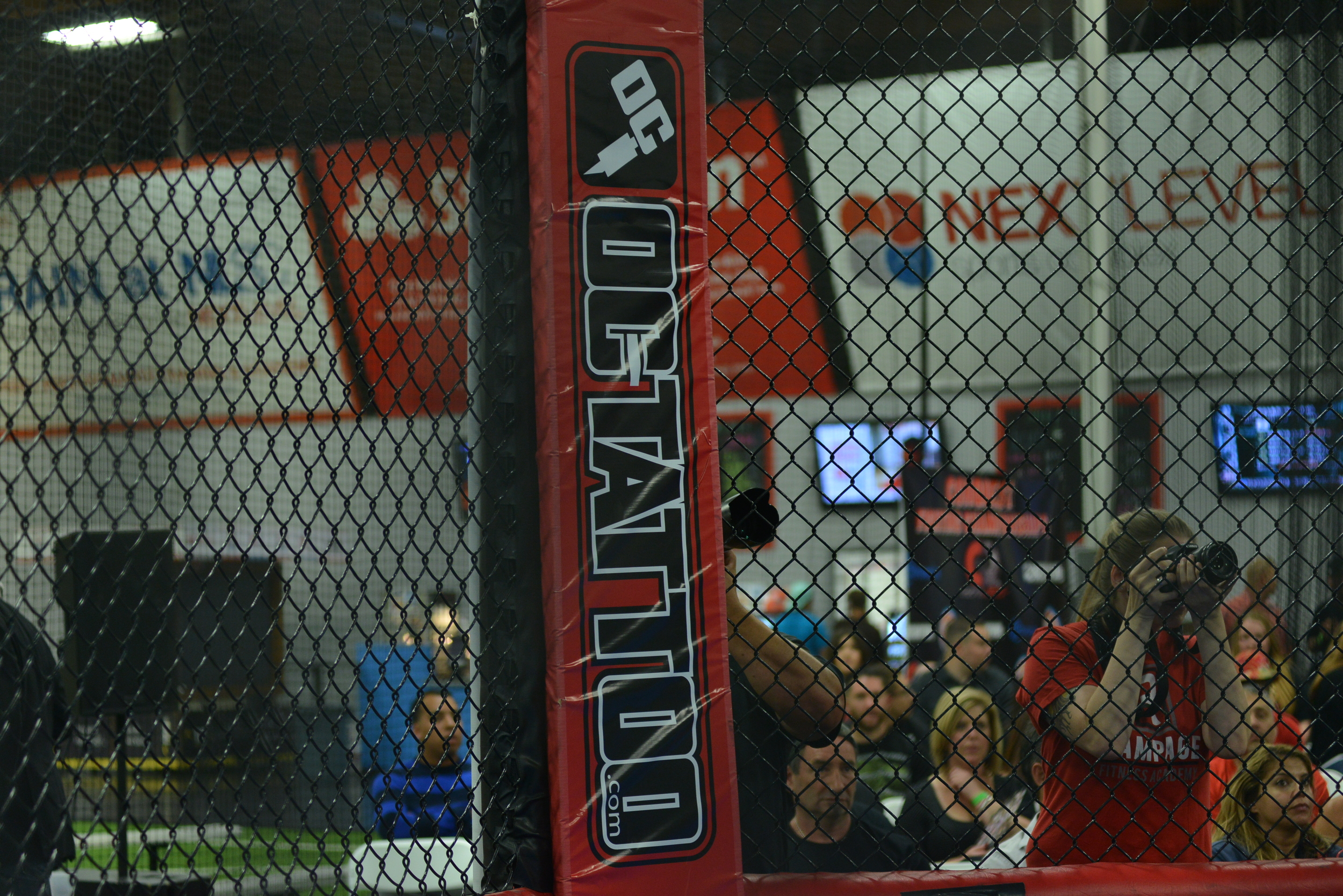 MMA Cage Sponsor OC tattoo