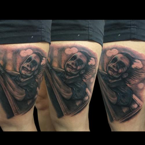 Slick tattoo artist