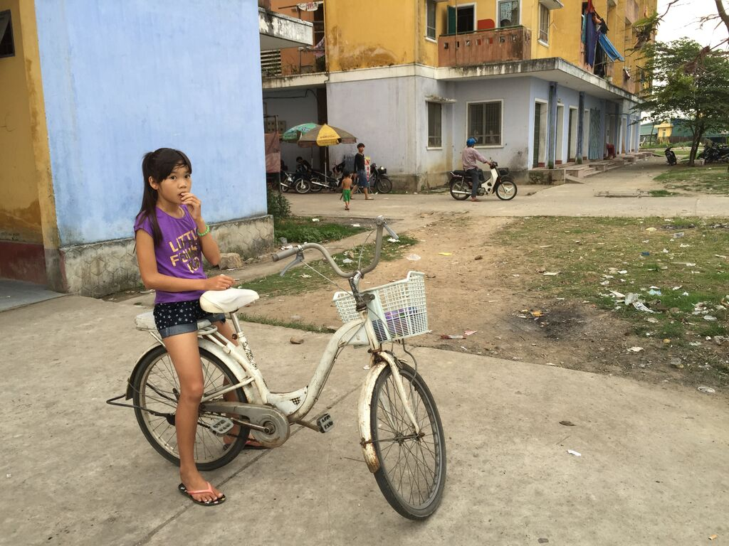 A young girl from the Phu Hiep community posing with her bike