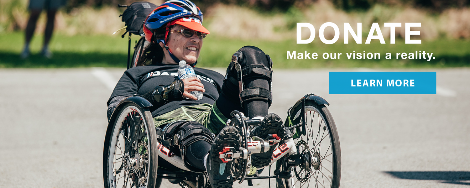 Athlete riding a cattrike bike. Donate. Make our vision a reality. Learn More.