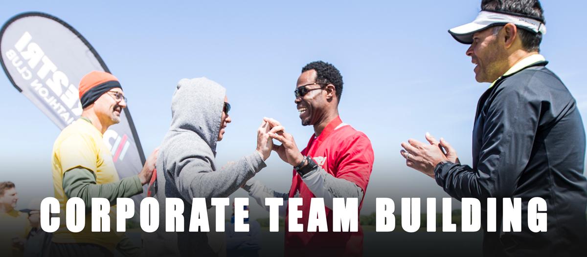 Corporate team building. Volunteers work with an athlete.