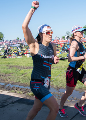 Ashley Eisenmenger running with a guide at Leon's Triathlon.
