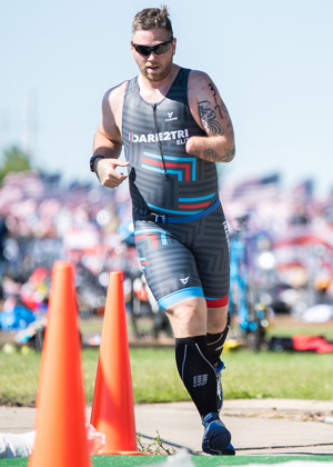 Athlete Dan St. Pierre running at Leon's Triathlon.