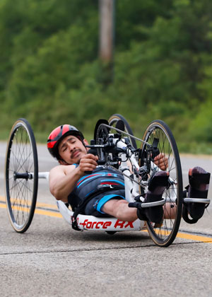 Athlete Jose Alexandre on a hand cycle during a race.