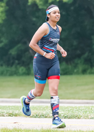 Athlete Dana Jatos running in a Dare2tri kit.