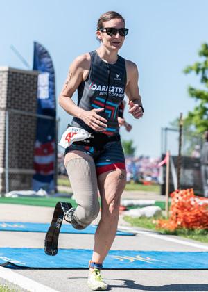 Athlete Dee Palagi running at Leon's Triathlon.