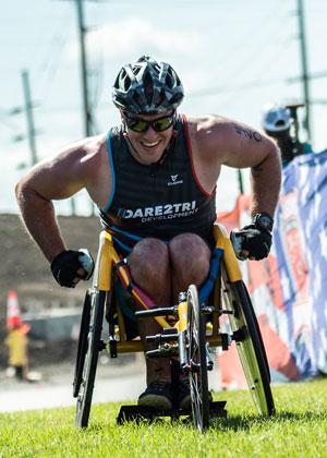 Dare2tri athlete James Veltri in his racing chair at Leon's triathlon.